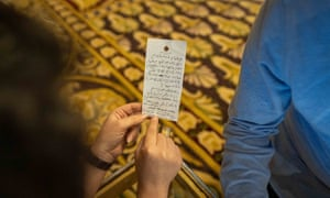 Aya Chebbi holds a hastily written draft of the fatwa on hotel notepaper