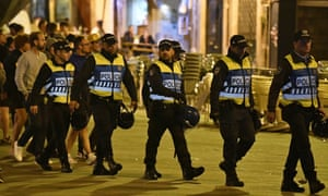 Police officers in Porto walk into position to monitor England supporters before the Nations League game against the Netherlands.