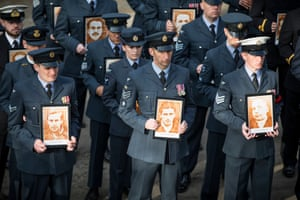 Zagan, PolandBritish RAF personnel parade with photographs of captured airmen that were shot after attempting to escape from Stalag Luft III during a remembrance service to commemorate the 75th Anniversary of the Great Escape.