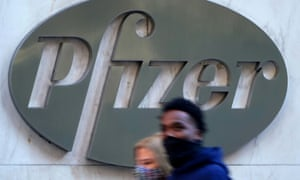 People walk past the Pfizer headquarters building in New York City.