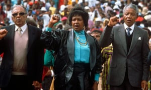 Ahmed Kathrada, left, alongside Winnie and Nelson Mandela at Soweto football stadium in 1990.