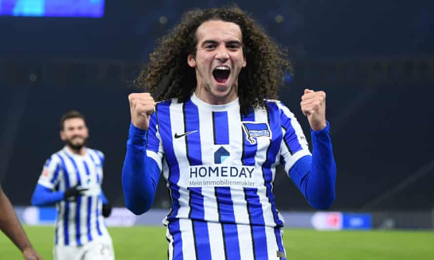 Hertha's on-loan Arsenal midfielder Matteo Guendouzi celebrates scoring the opening goal against Schalke.