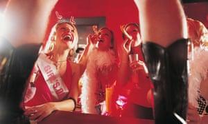 A hen party watching a stripper