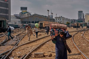 Commuters make their ways across the tracks at Cairo's main railway station