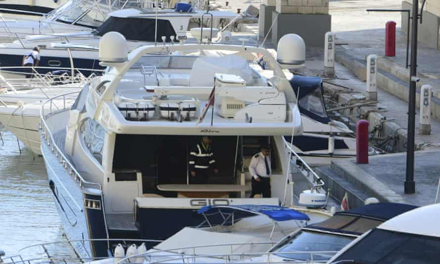 Police onboard Yorgen Fenech's yacht Gio, after it was intercepted by the Maltese military early on Wednesday and forced back to Portomaso, Malta.