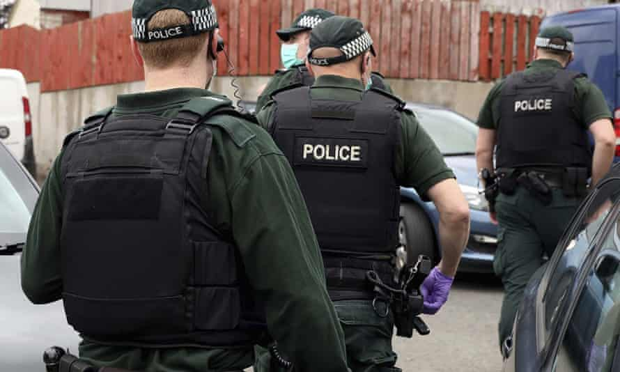 Police Service of Northern Ireland officers during a raid in 2020