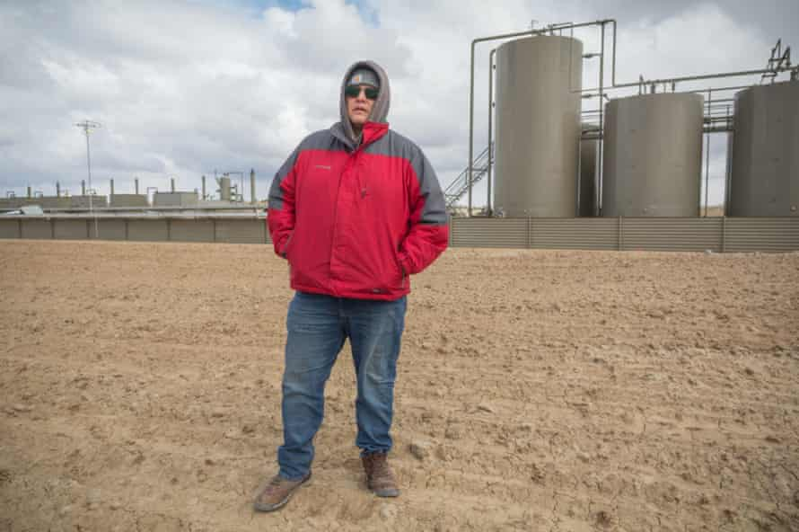 Mario Atencio stands in front of the wellsite that leaked fracking slurring into a wash near his grandmother's home in 2019. ©2021/Jerry Redfern