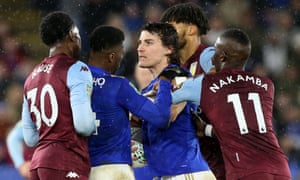 Caglar Soyuncu of Leicester City and Kortney Hause of Aston Villa have to be separated by Kelechi Iheanacho of Leicester City, Tyrone Sings of Aston Villa and Marvelous Nakamba of Aston Villa.