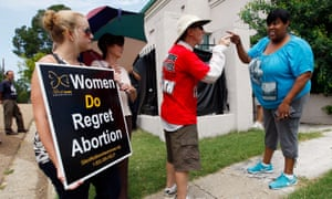 Abortion opponents argue with the Jackson Women's Health Organization's administrator Shannon Brewer, right, over opponents trespassing onto the property of Mississippi's only abortion clinic.