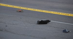 A shoe and some plastic debris on the road after incident.