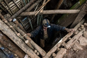 A miner entering a tunnel in a ruby mine in Mogok, north of Mandalay