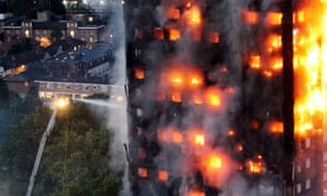 Firefighters tackle the Grenfell Tower blaze as dawn breaks