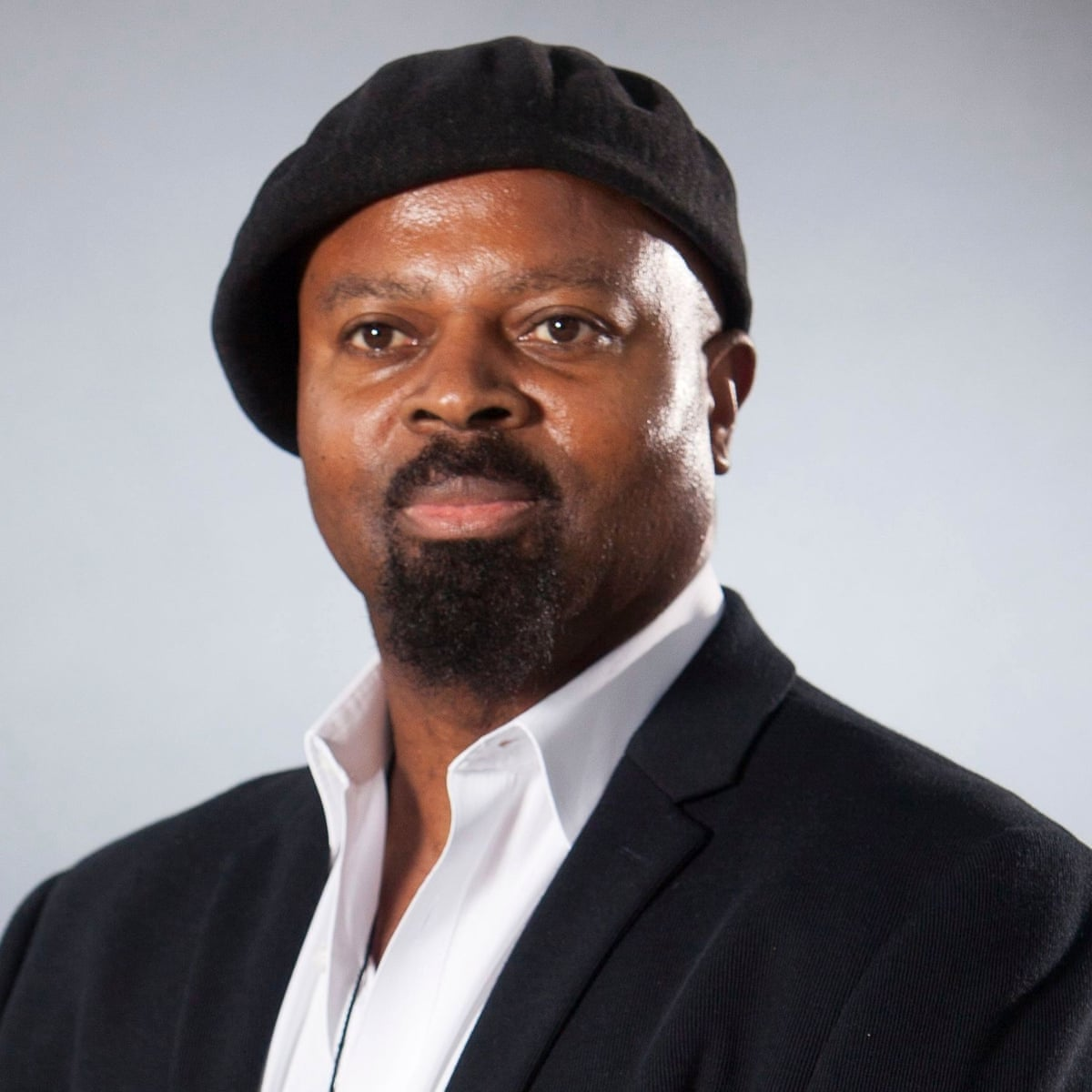 Ben Okri: 'I was nearly shot because I couldn't speak my dad's language' |  Theatre | The Guardian
