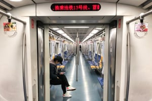 A largely empty subway train in Beijing. Millions of people across China are in lockdown.