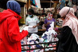 Jackline Bosibori, 17, shops for second-hand baby clothes at the Toi market in Nairobi, Kenya, 21 July 2020.