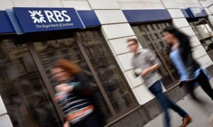 Pedestrians pass an RBS branch