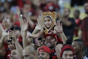 Rio de Janeiro, Brazil: Flamengo fans cheer before a Copa Libertadores match against Uruguay's Penarol at the Maracana stadium