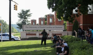 Students and faculty wait near the entrance of the University of North Carolina Charlotte campus on 30 April 2019.