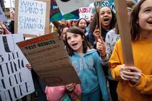 Students gather with their signs in London. They are calling on the government to declare a climate emergency