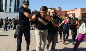 Turkish police detain two students during a protest in Diyarbakır