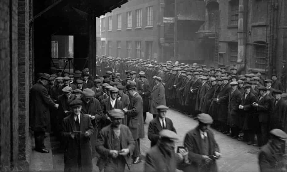 17 March 1931: Unemployed labourers waiting for work at a dockyard.