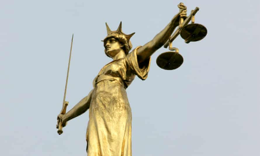 The Lady Justice statue on the dome of the Old Bailey courts building in London.