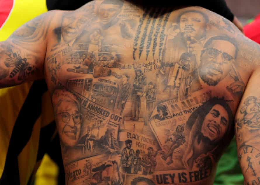 Rosa Parks, Malcolm X, Martin Luther King, Bob Marley and Nelson Mandela tattooed on Andre Gray's back
