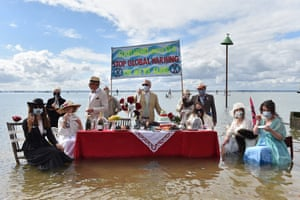 Southend-on-Sea, EnglandExtinction Rebellion protesters stage a Titanic-themed dinner party in the sea to illustrate the threat of rising sea levels, on Chalkwell beach