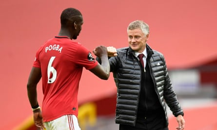 Ole Gunnar Solskjær bumps fists with Paul Pogba after a match in July.