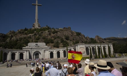 People queue to enter the alley of the Fallen monument near San Lorenzo del Escorial, in Madrid province
