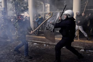 A farmer clashes with riot police