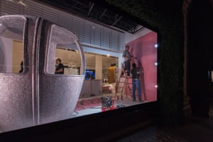 A silver pod installed in the window