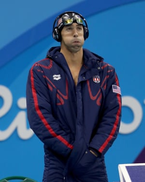 Could that be First Place Winner in Michael Phelps's ears?