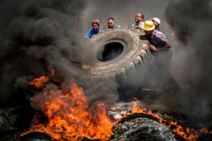 Johannesburg, South AfricaEnnerdale community members burn tyres to protest the lack of police and government action against drug abuse, for better housing and basic services in the area, on October 5, 2018 in Johannesburg's Ennerdale suburb, South Africa.