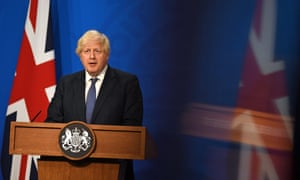 Boris Johnson tells people to be cautious to temper a huge case surge despite removing last Covid restrictions in England.