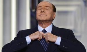 Silvio Berlusconi adjusting his tie during the recording of the Italian Rai 1 television programme 'Porta a porta'.