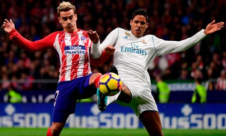 Antoine Griezmann vies with Real Madrid defender Raphaël Varane.