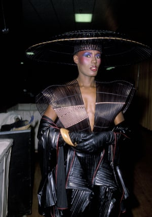 By 1983, the success of Warm Leatherette, Nightclubbing and Living My Life had made Jones a star. She began to collaborate on her image with art director Jean-Paul Goude, adopting a capital-F Fashion look. such as this laser-cut leather number for the Grammies that year, complete with her soon-to-be-trademarked accessory: a really great hat. Photo by Ron Galella/WireImage