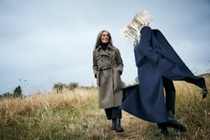 From left, Kahti wears fawn trench, top and trousers, all margarethowell.co.uk, and boots, joseph-fashion.com. Jane wears blue cashmere coat, jumper and trousers, all maxmara.com, and boots, uk.maje.com