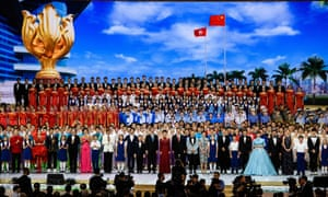 The Chinese president, Xi Jinping (centre, in a red tie), at a variety show in Hong Kong to mark 20 years since Britain returned Hong Kong to China.