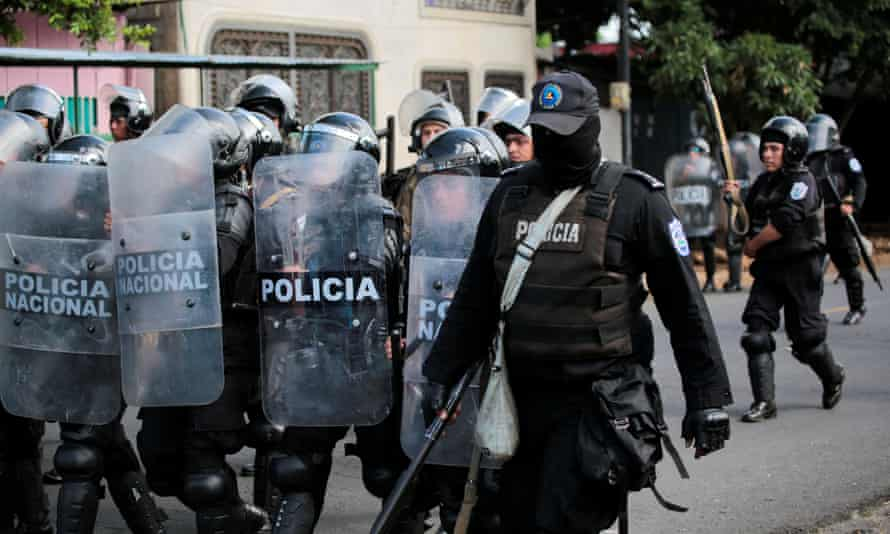 Riot police patrol the streets during a protest against Daniel Ortega in Managua.