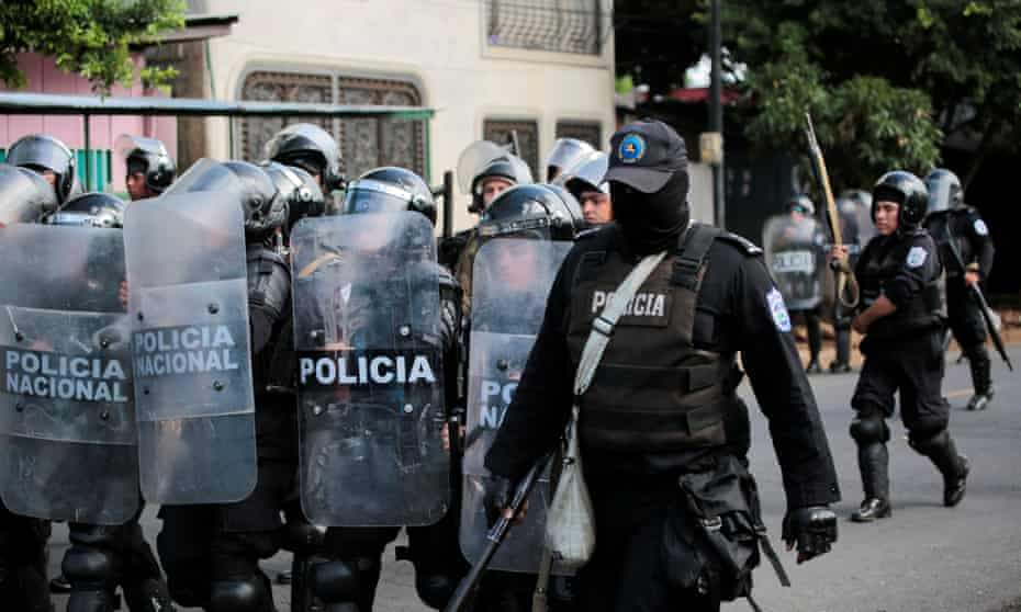 Riot police patrol the streets during a protest against Daniel Ortega in September.