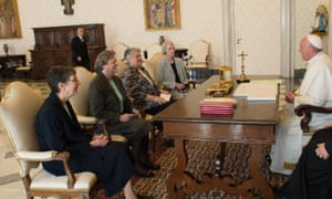 Pope Francis, right, talks with a delegation of the Leadership Conference of Women Religious during an audience in the pontiff's studio at the Vatican on Thursday.