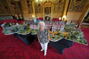 Sandringham, UK. Margaret Seaman, aged 92, stands next to her creation 'Knitted Sandringham', on display in the Ballroom of Sandringham House. The woollen model, which has taken two years to complete, includes St Mary Magdalene Church, Alexandra's Nest summer house, lakes, gardens and visitors as well as the main house