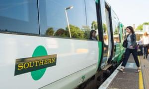 A woman boards a Southern Railway train