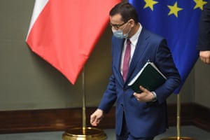 Polish prime minister Mateusz Morawiecki wears a protective mask as he attends a parliamentary debate in Warsaw
