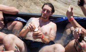 Festival goer Alic drinks a beer in a makeshift pool in a pickup bed during Audiofeed Festival in Urbana, Illinois on Saturday, July 1, 2017. The party was later broken up by security; Audiofeed is an alcohol-free festival.