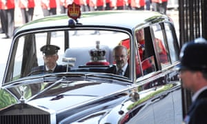 Britain's Queen Elizabeth's crown is driven to the state opening of parliament.