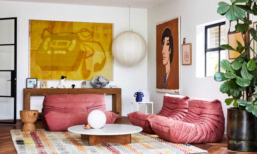 'Sometimes I think, why couldn't I just have chosen something beige and classic?' Large artworks and Ligne Roset chairs in the sitting room.