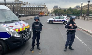 Officers guard the Paris police headquarters where Mickaël Harpon killed four colleagues.